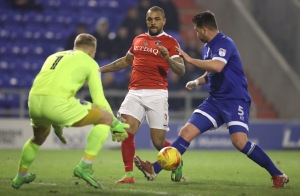 Charlton Athletic's Josh Magennis (centre) battles for the ball with Oldham Athletic's Anthony Gerrard (right)  and goalkeeper Connor Ripley